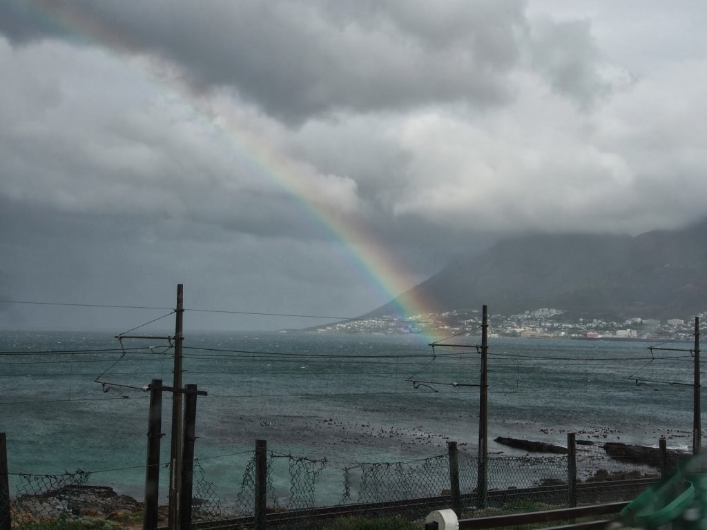 Rainbow in the gloom of  Simonstown.