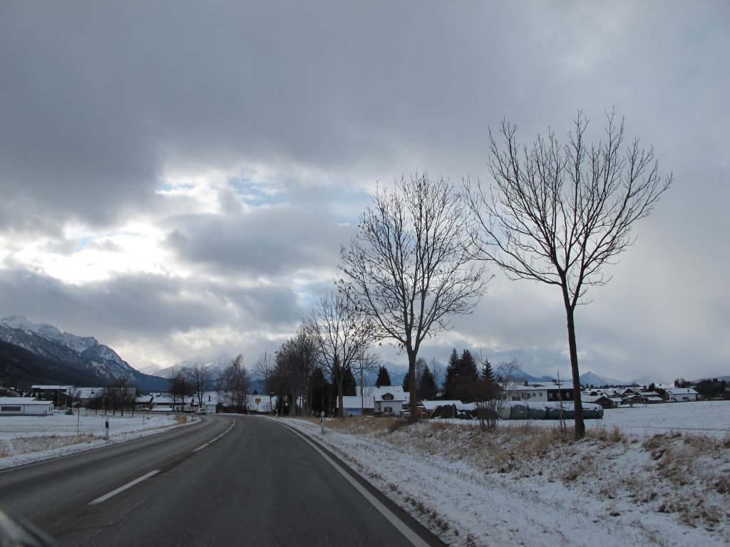 With mountainous backdrop.