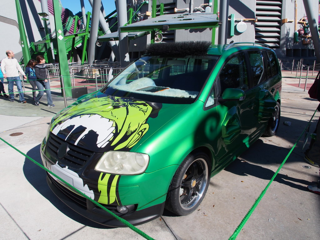 Car with the Hulk designs and smashed doors.