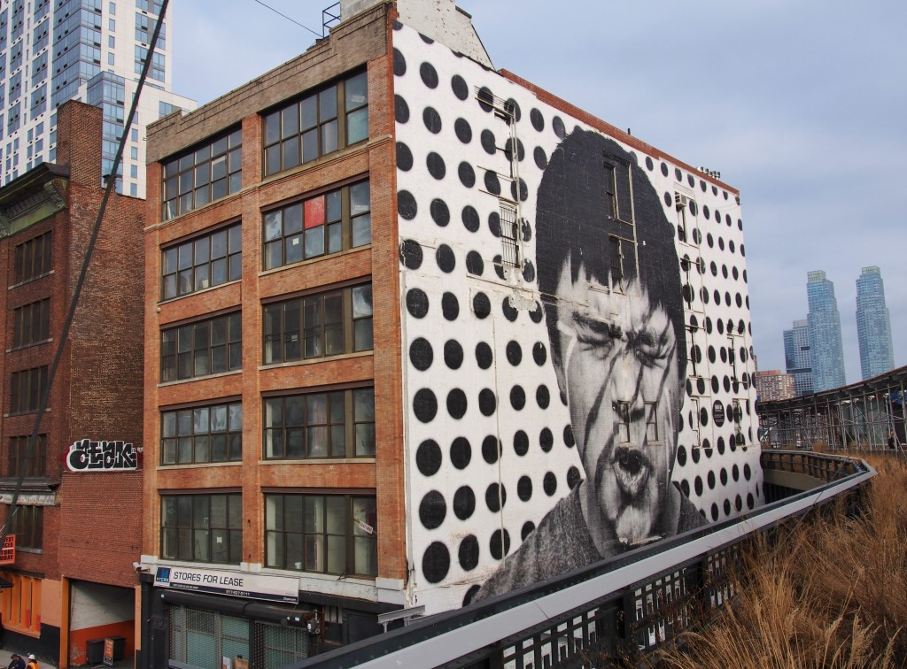 Huge portrait painted on side of the building.