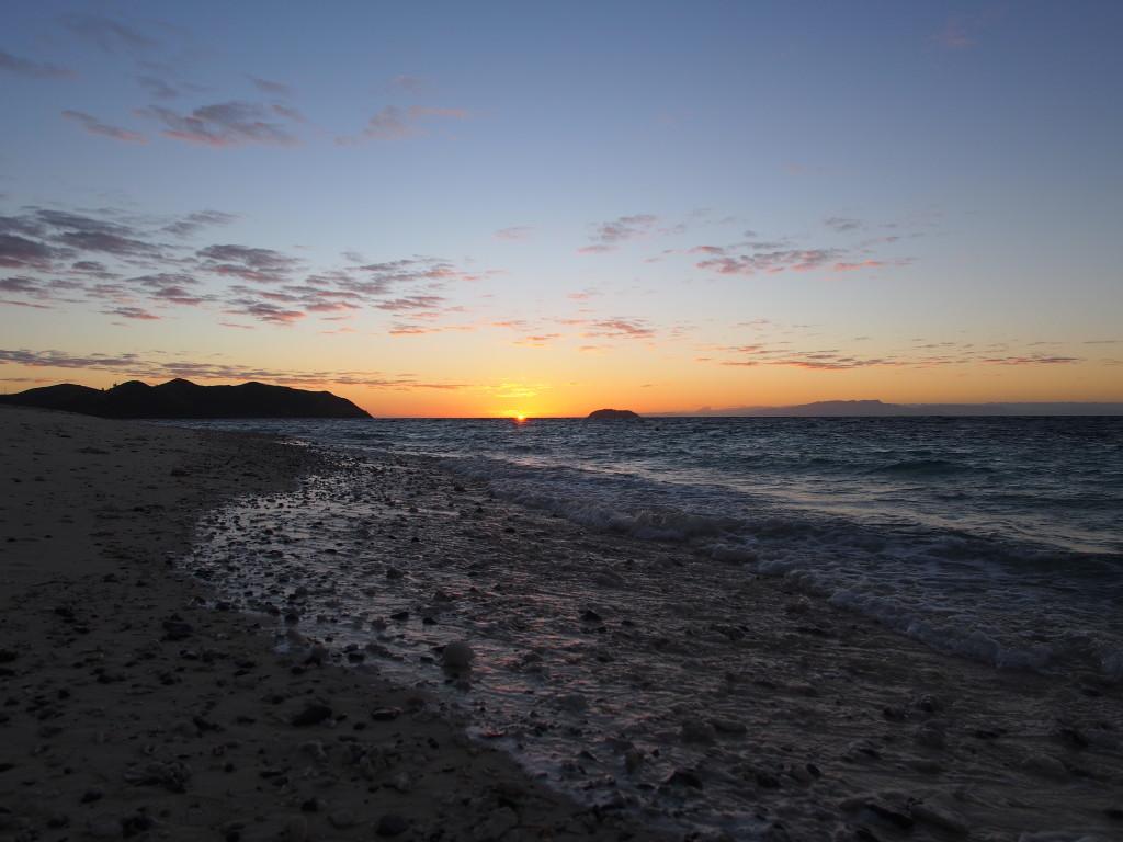 As the sun peeks over the horizon.