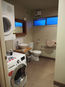 Toilet with washing machine and dryer.