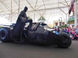 Dark Knight arrived on his Batmobile.