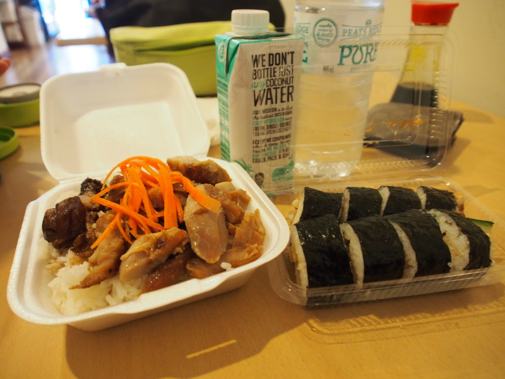 Teriyaki chicken and sushi.