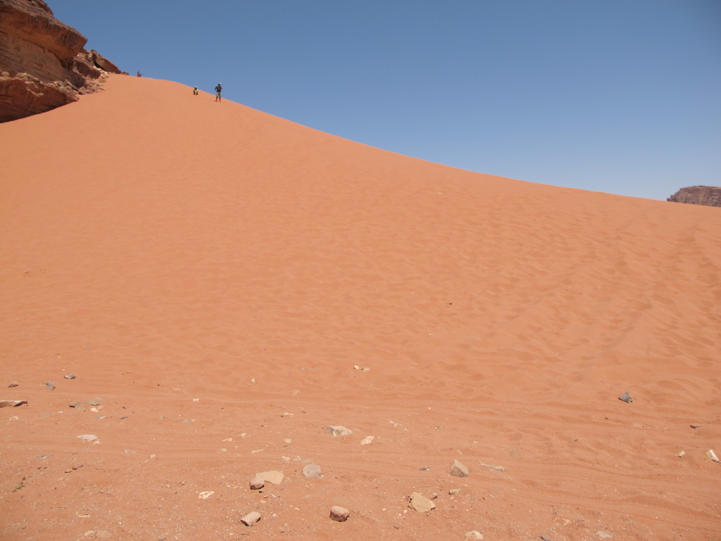 Sand dune, high pile of sand which was so difficult to climb.