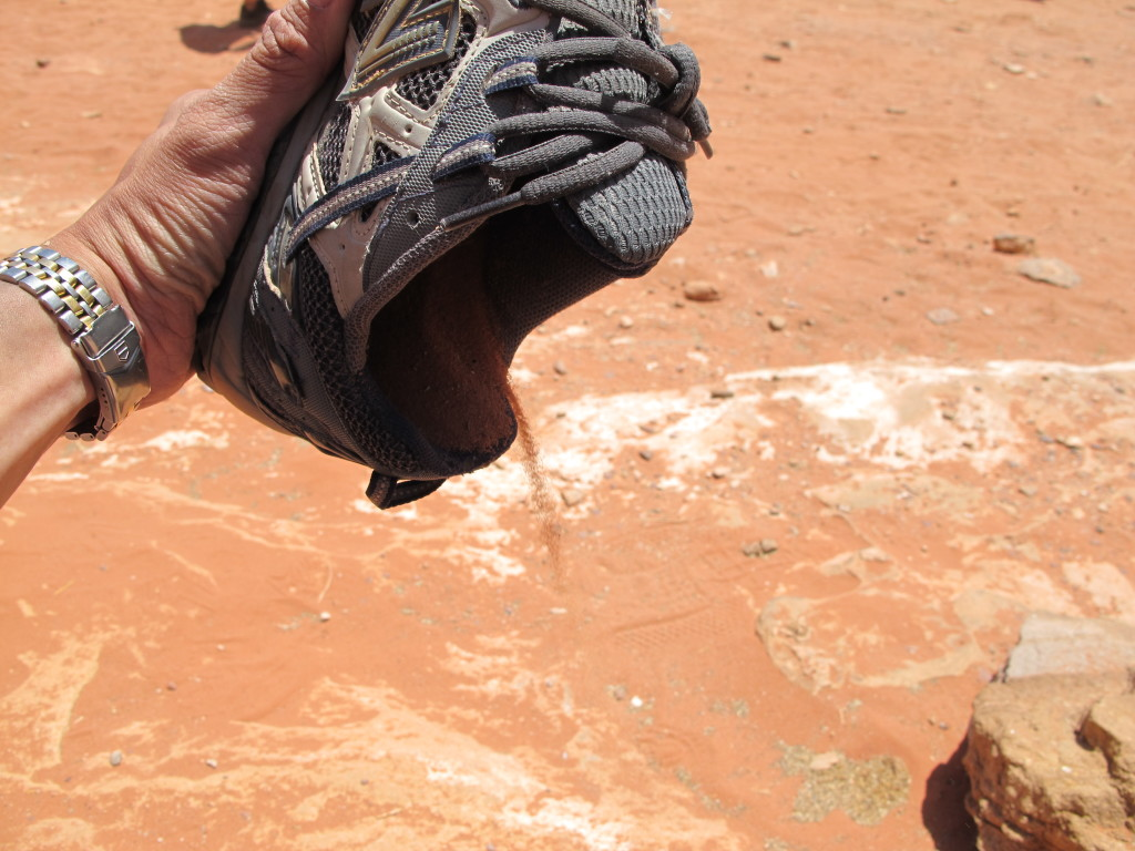 Shoes flooded with sand.
