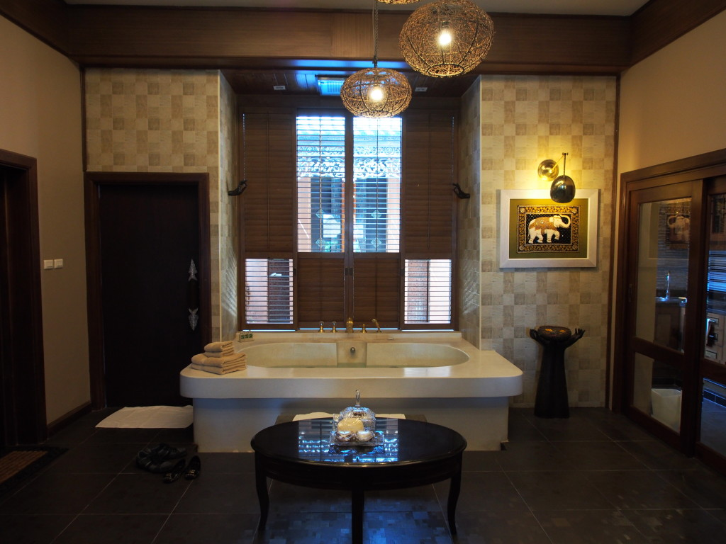 Large in room stone jacuzzi tub.