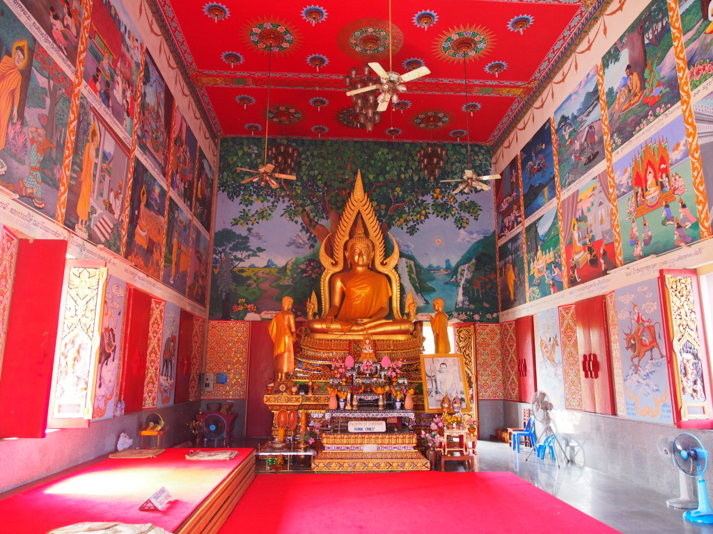 Inside the temple with colourful walls.