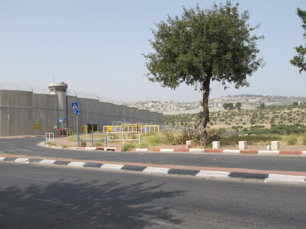 Approaching the walled city of the Palestinian Authority.