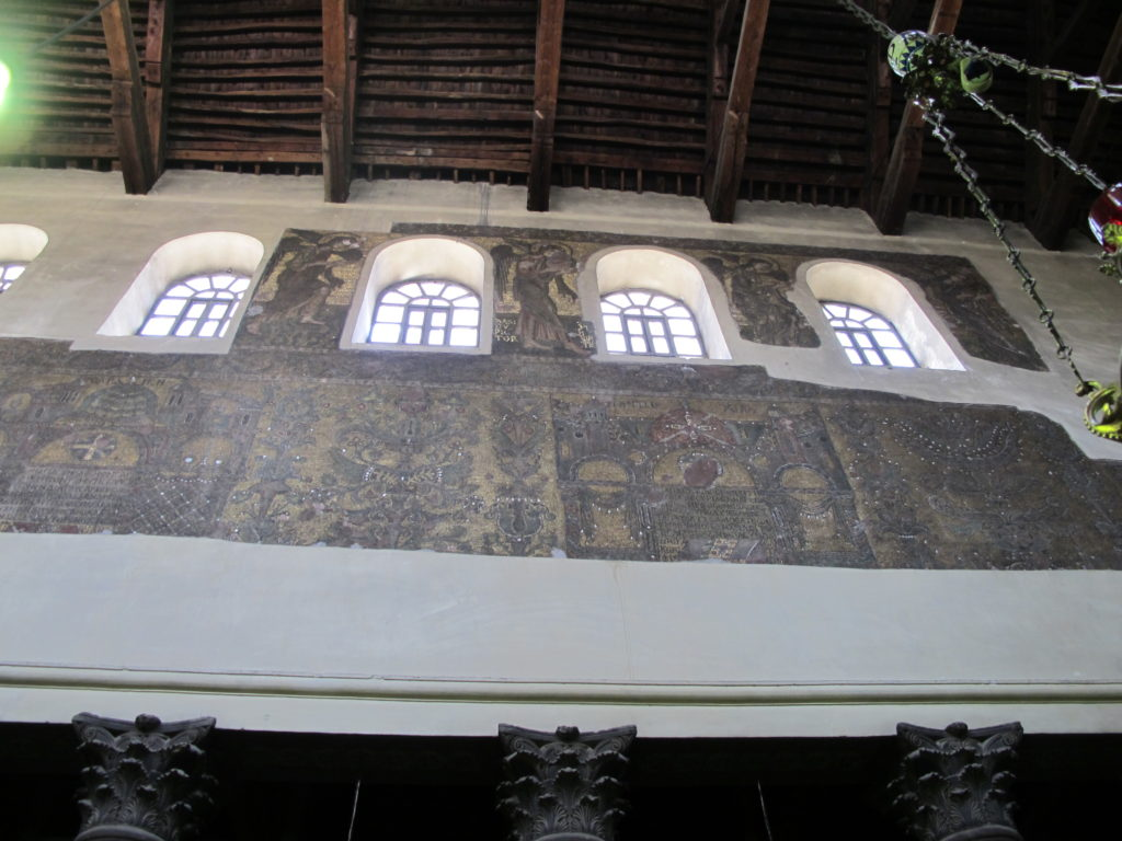 Mosaic filled walls within the church.
