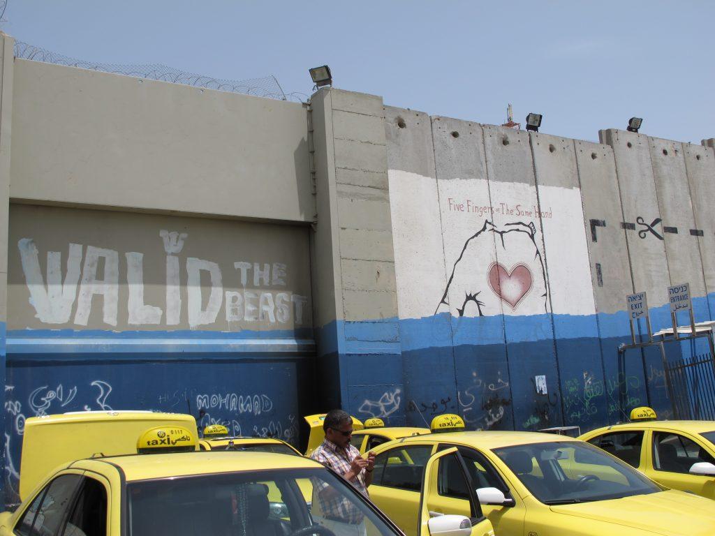 Graffiti on the surrounding wall.
