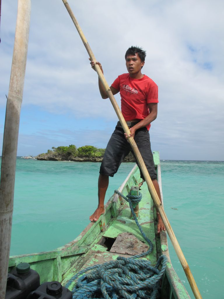 Tough boatman steering the boat.