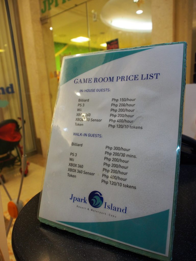Price list at the games arcade.