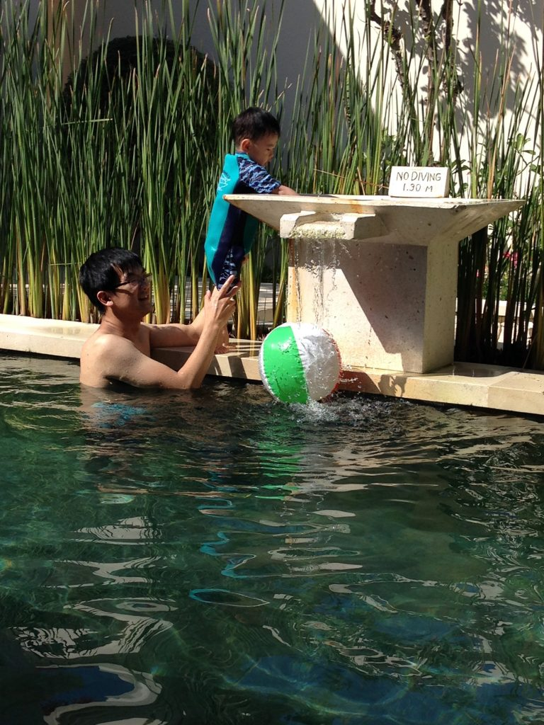 Father and son at the villa pool.